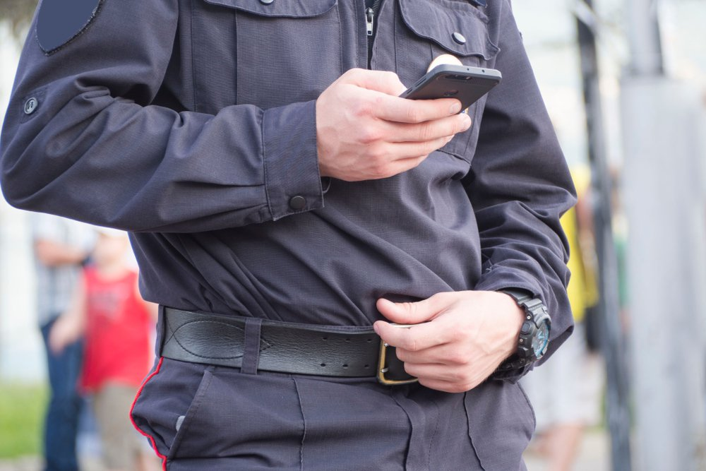 policeman with a smartphone