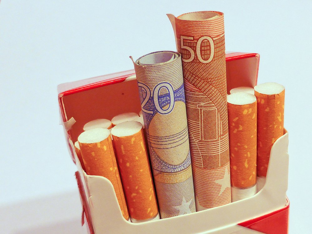 euro banknotes in the cigarette pack