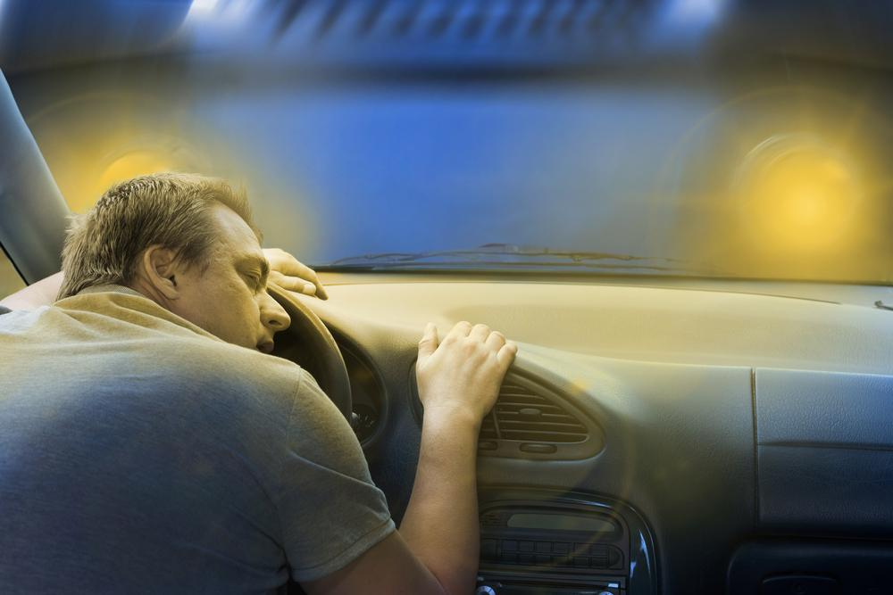 driver sleeping in car