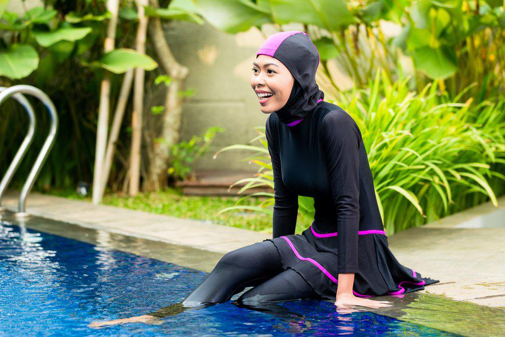 women in burkini in the swimming pool