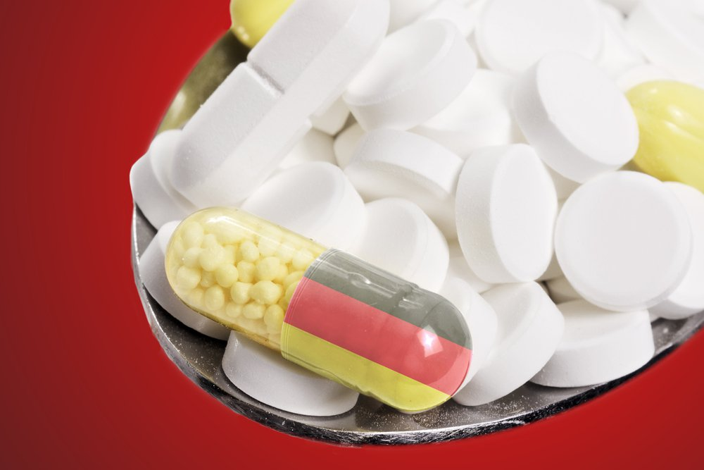 The national flag of Germany on a capsule and pills