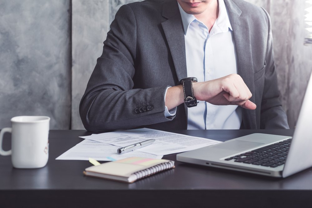 businessman looks at his watches