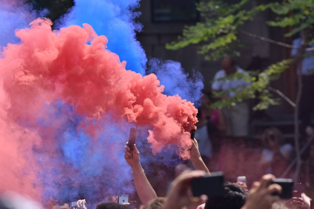 football fans use colored smoke bombs