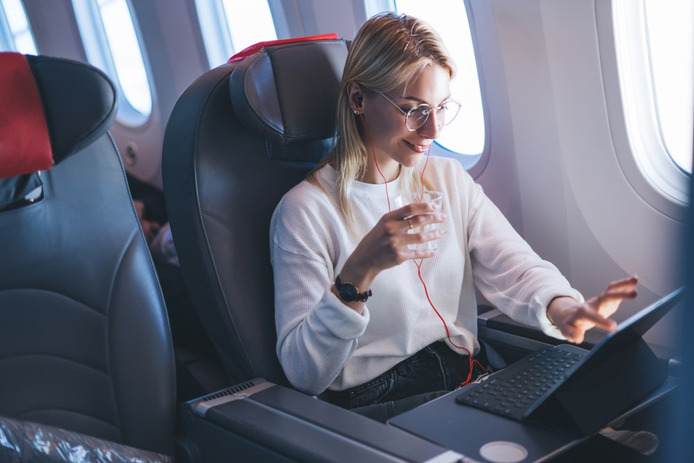 woman watching online movie during the flight