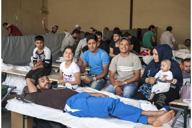 Как африканские мигранты помогают беженцам вГермании фото 1