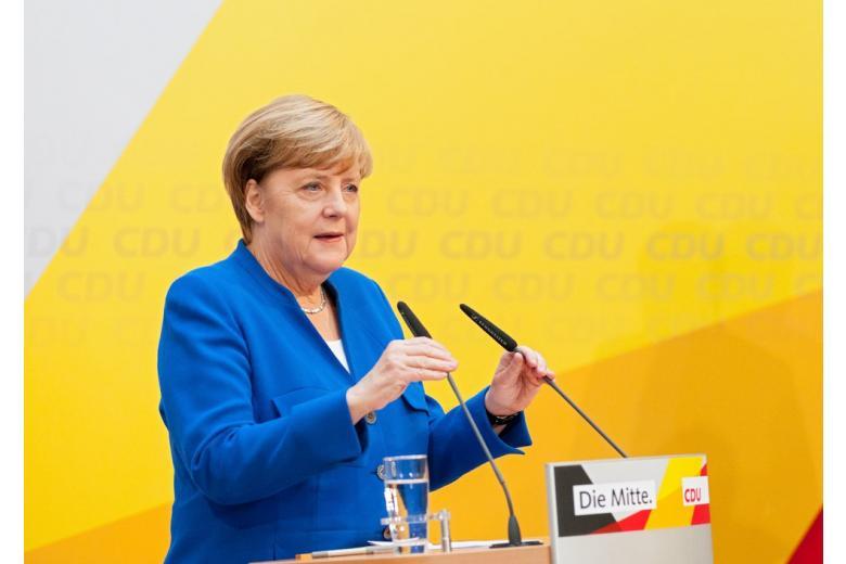 В Германии обнародована часть проекта коалиционного соглашения фото 1