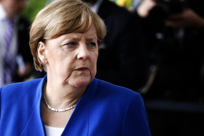 Меркель встретилась с родственниками жертв берлинского теракта фото 1