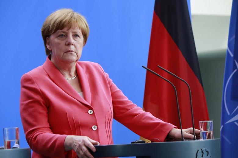 Меркель планирует саммит по вопросам нелегальных мигрантов фото 1