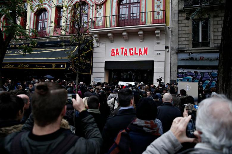 People pay their respects to the victims of the attack on the Bataclan, Paris