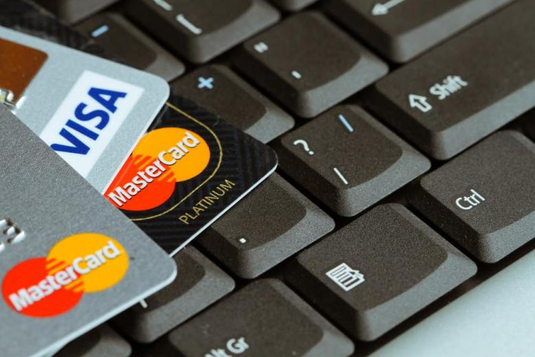 credit cards on top of a laptop keyboard