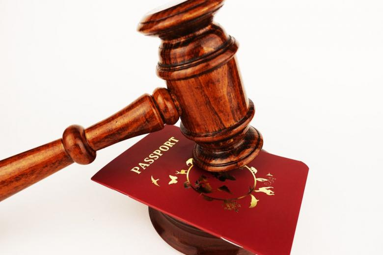 Immigration law concept with judge gavel and passport