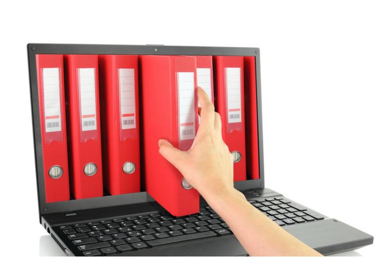 Laptop online with red ring binders