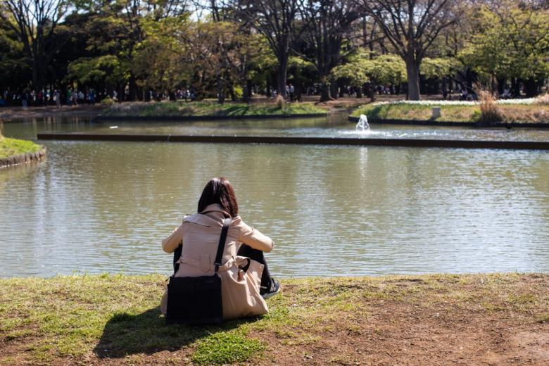 girl sitting near the lake