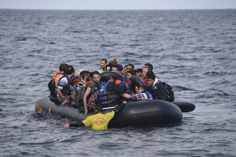 беженцы на лодке