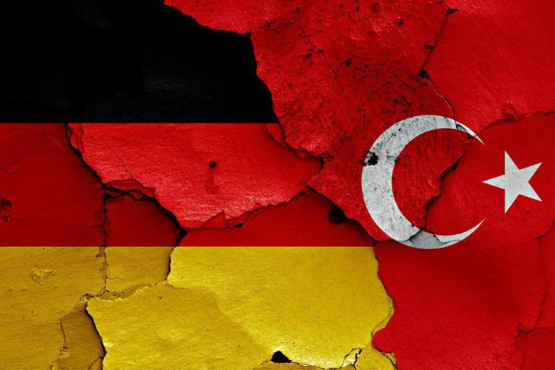 flags of Germany and Turkey painted on cracked wall