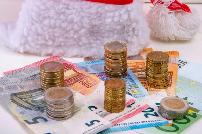 christmas hat with money euro coins and notes