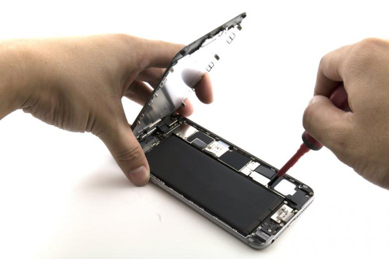 man replacing mobile phone batteries