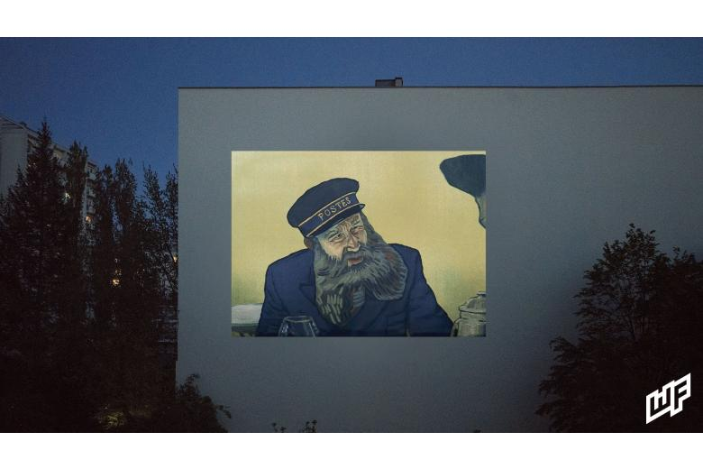 Кинопоказ на фасаде дома в Берлине фото
