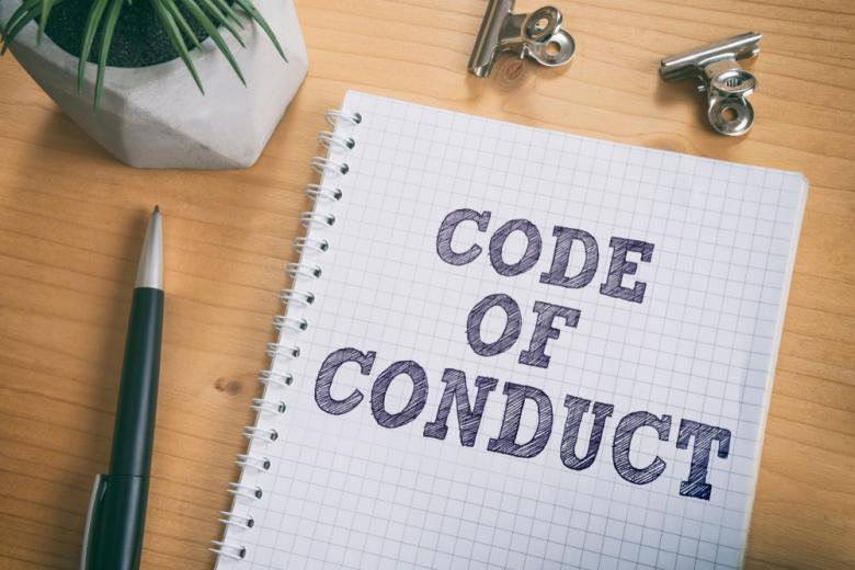 Кодекс поведения - надпись на листе блокнота фото