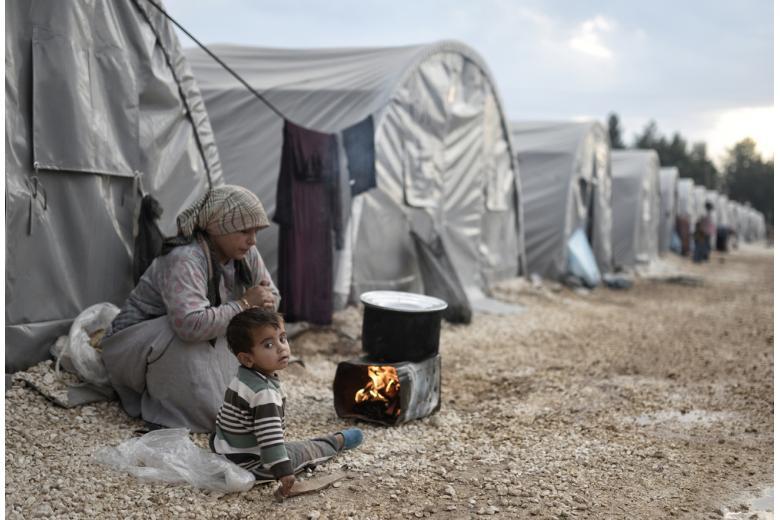беженка с ребенком фото
