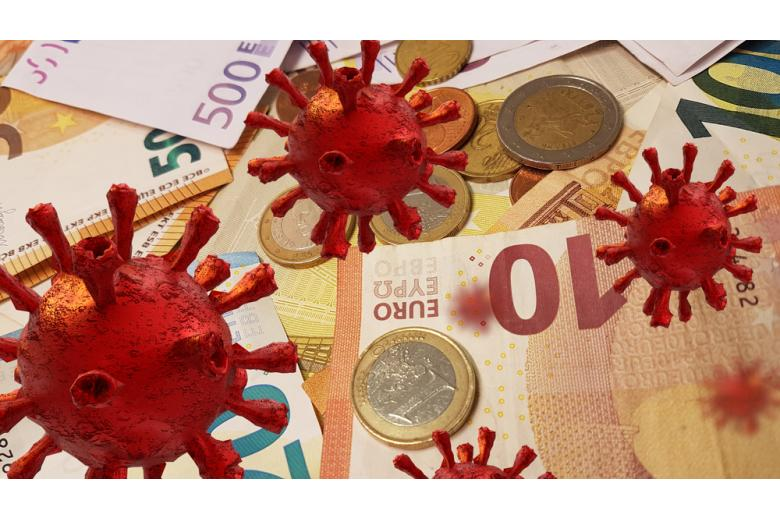 коронавирус Ковид-19 и банкноты евро на фоне фото