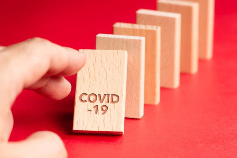 Цепочка домино от COVID-19 фото