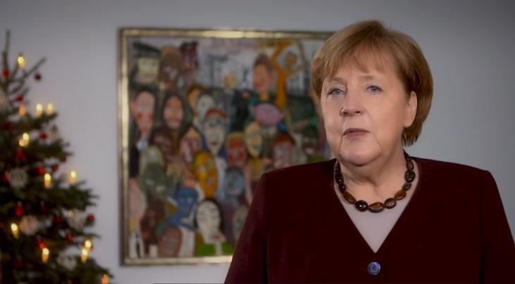 Меркель обращается к немцам, которое выполняют особую миссию фото