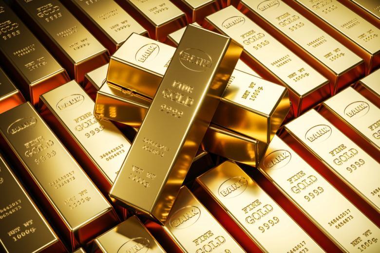 Золотые слитки в банковском хранилище фото