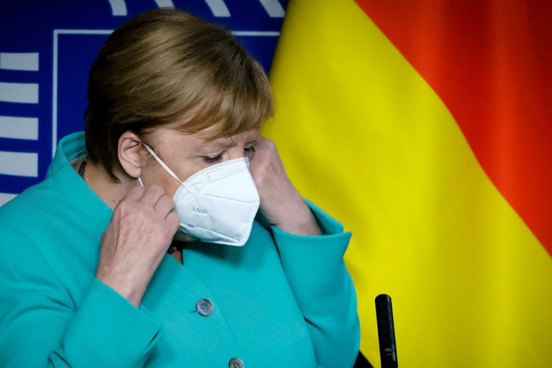 Меркель надеется на слабый свет в конце тоннеля фото