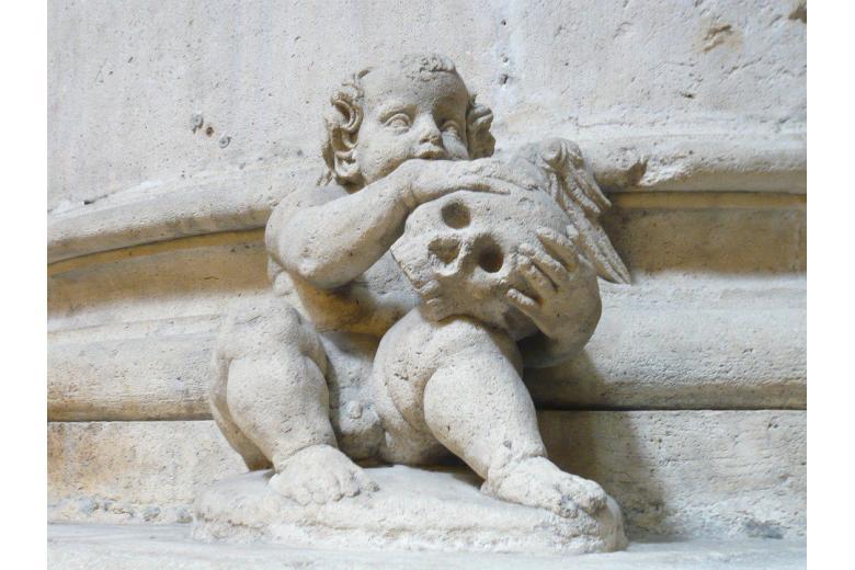 статуя ангелочек с черепом фото